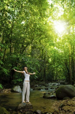 6903854-young-woman-arms-opened-enjoying-the-fresh-air-in-tropical-green-forest