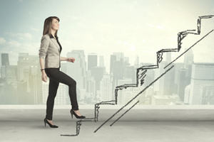 38002730 - business woman climbing up on hand drawn staircase concept on city background
